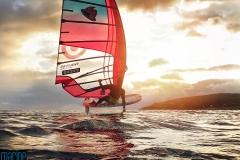 Hydrofoil windsurf sailing against the sun