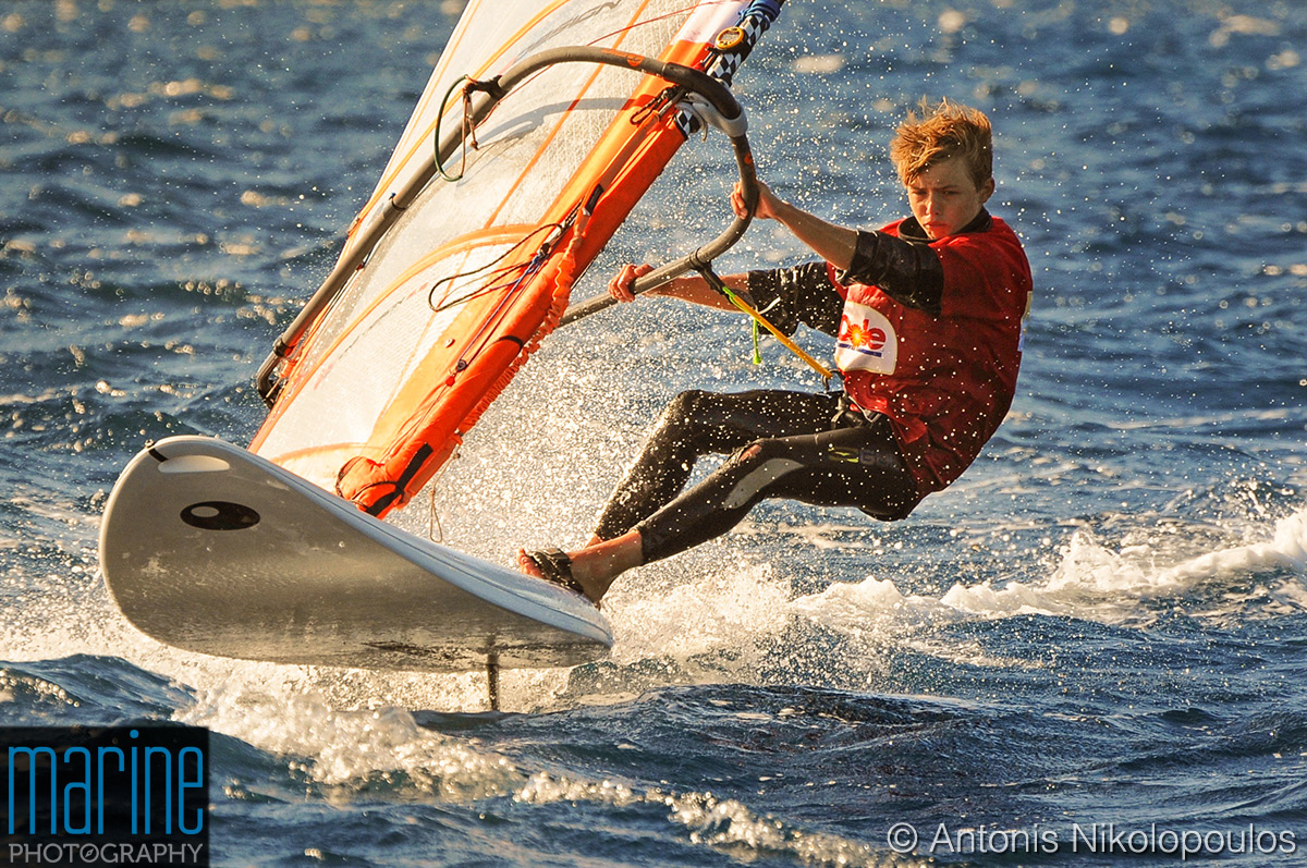 Techno 293 European Championship in Varkiza, Greece. Finishing a high wind windsurfing race.
